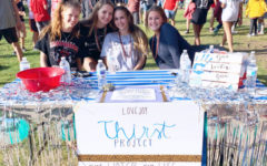 (from left to right) Haley Mise, Addison Hand, Amy Cummings, and Emma Wenaas run the Thirst project club on Leopard Friday.