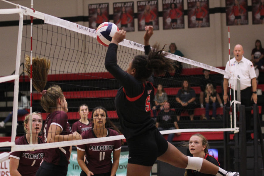 Sophomore Cecily Bramschreiber looks to block a Princeton spike.