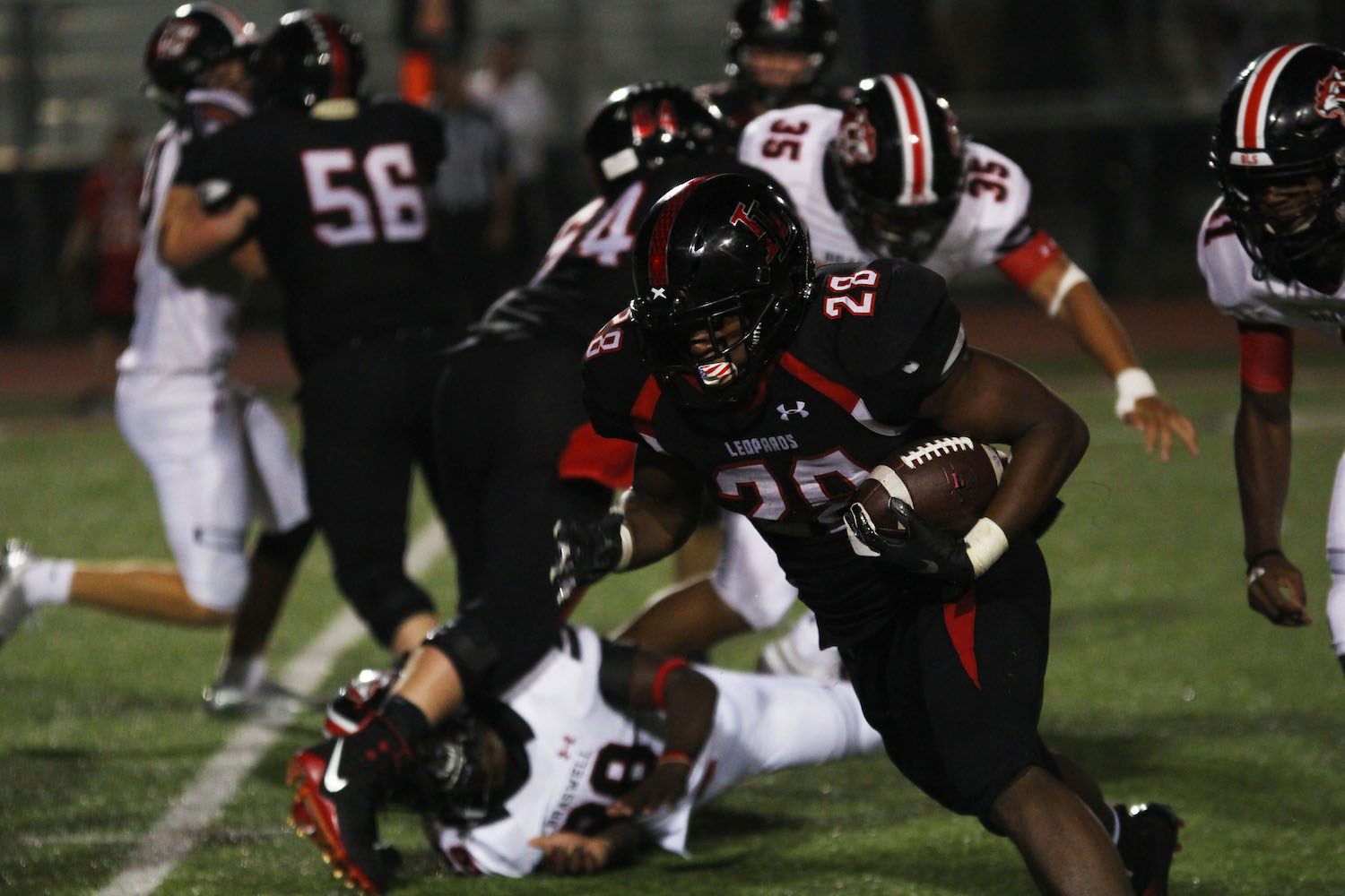 Senior running back Jahi Rainey looks to turn up field to reach the first down marker.