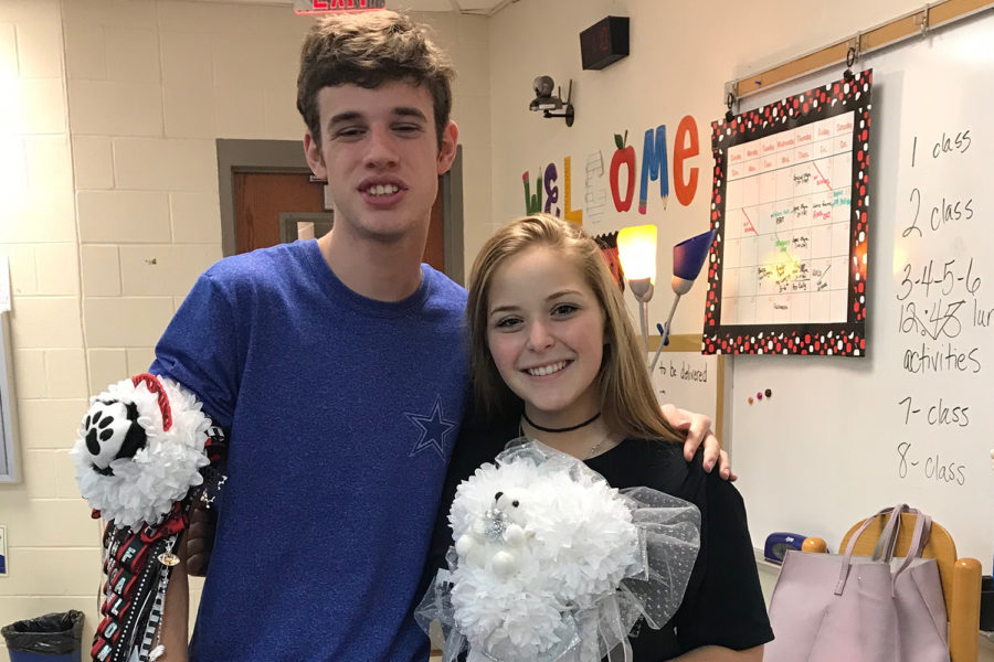 Sophomore+Falon+Simmons+poses+with+his+Homecoming+date%2C+senior+Aubrie+Shinedling%2C+on+Thursday.