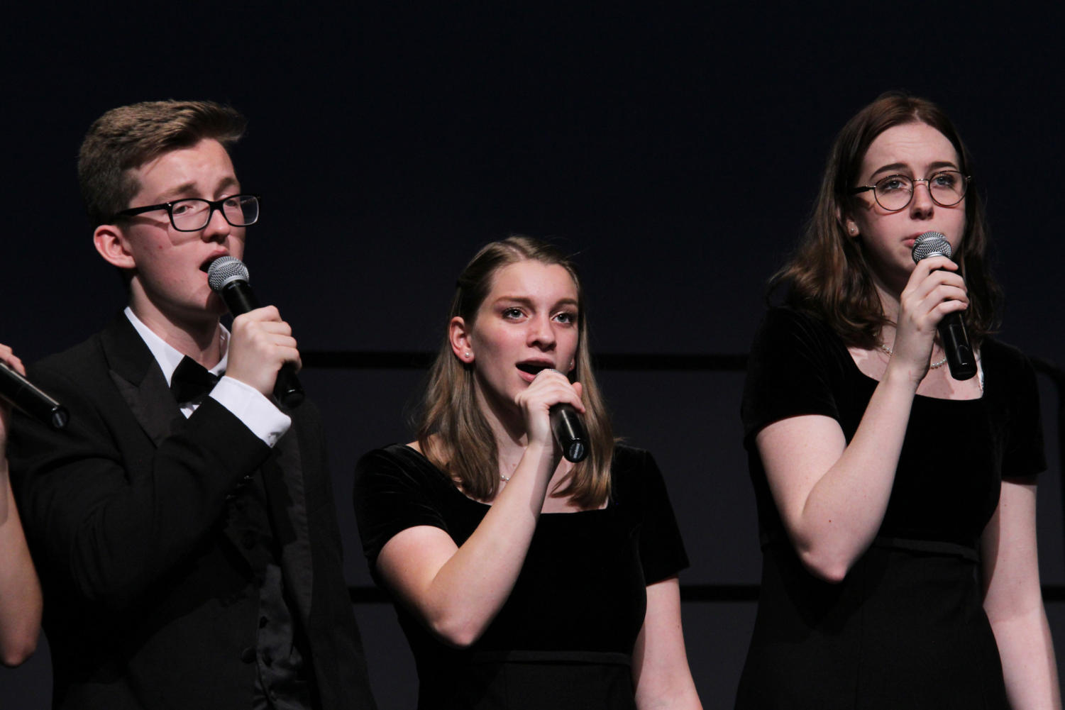 Senior Marcie Sawyers (center) sings with juniors Stephen Godfrey (left) and Claire McLaren (right) during a concert.