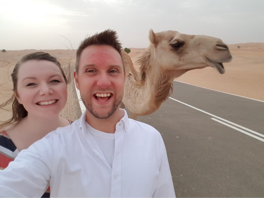 The+Daughertys+pose+with+a+camel+while+on+one+of+their+numerous+excursions.+