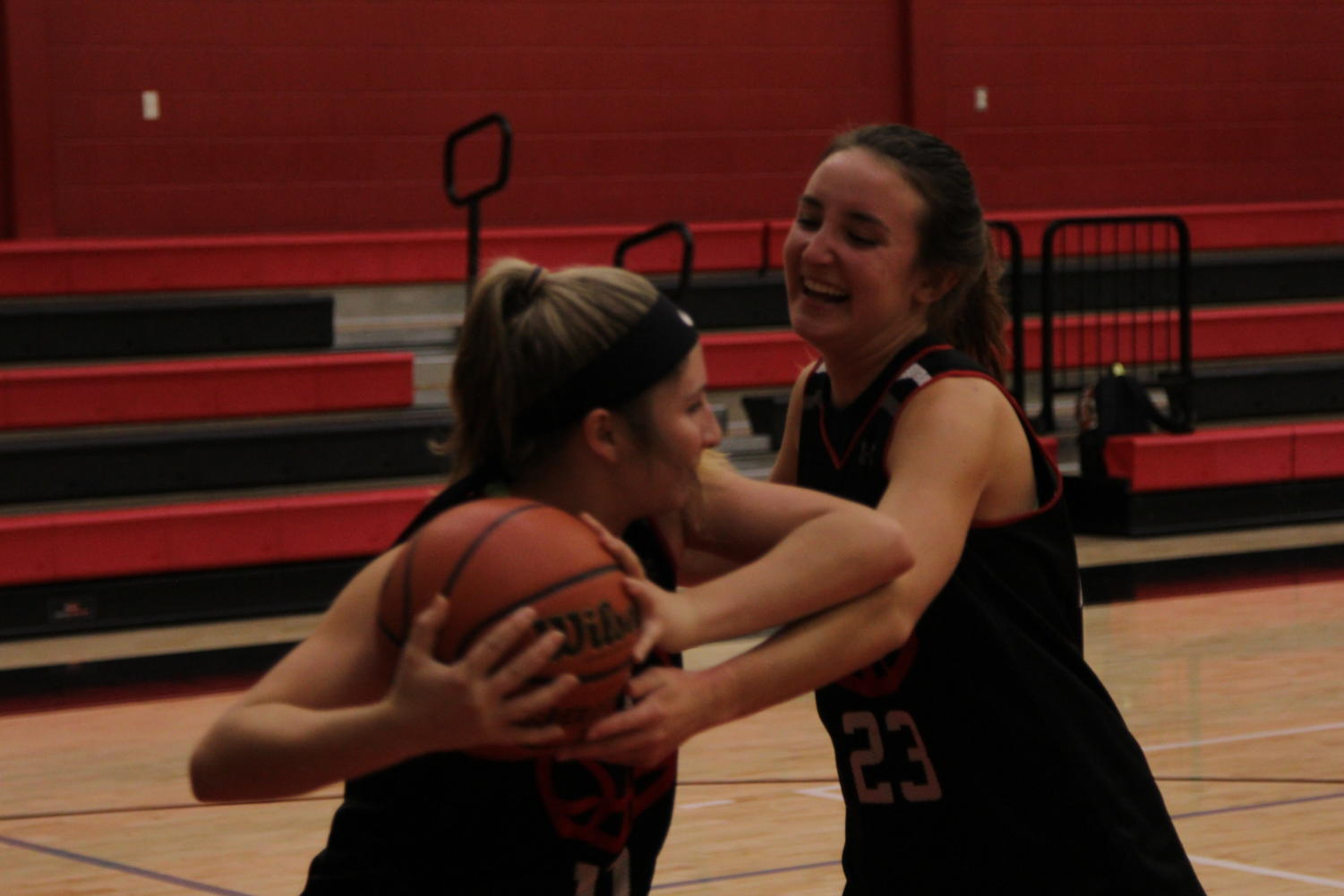 Junior Mallory Adamson defends a teammate in practice.