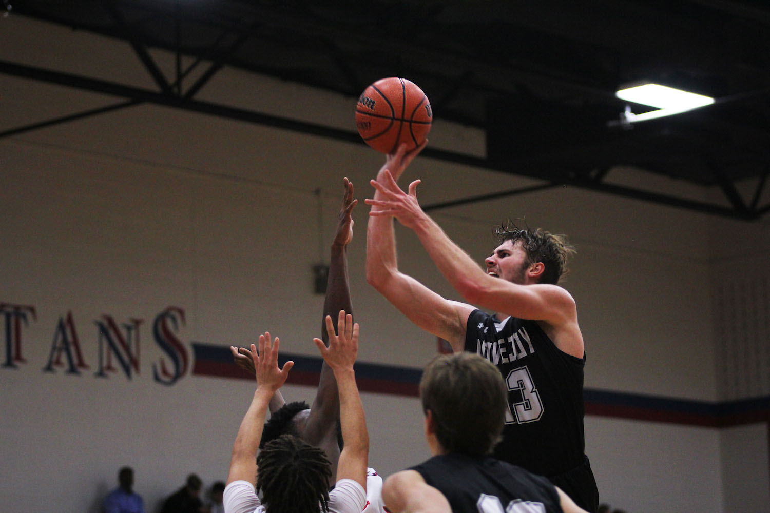 Senior Kyle Olsen elevates over the defense in attempts to make a layup.
