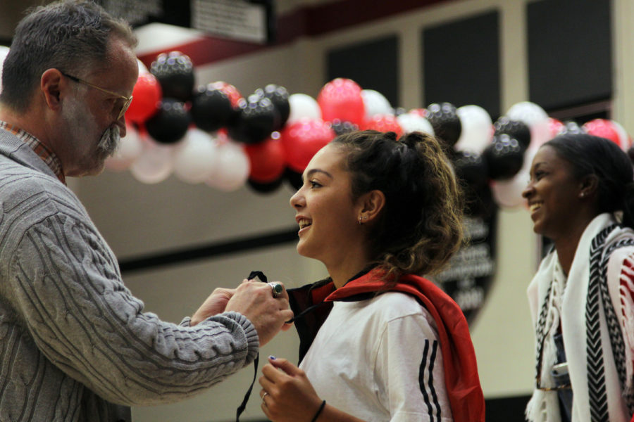 Musical chairs retiree Mr. Cooper brings a new player junior Reagan Matacle to play in his honor.
