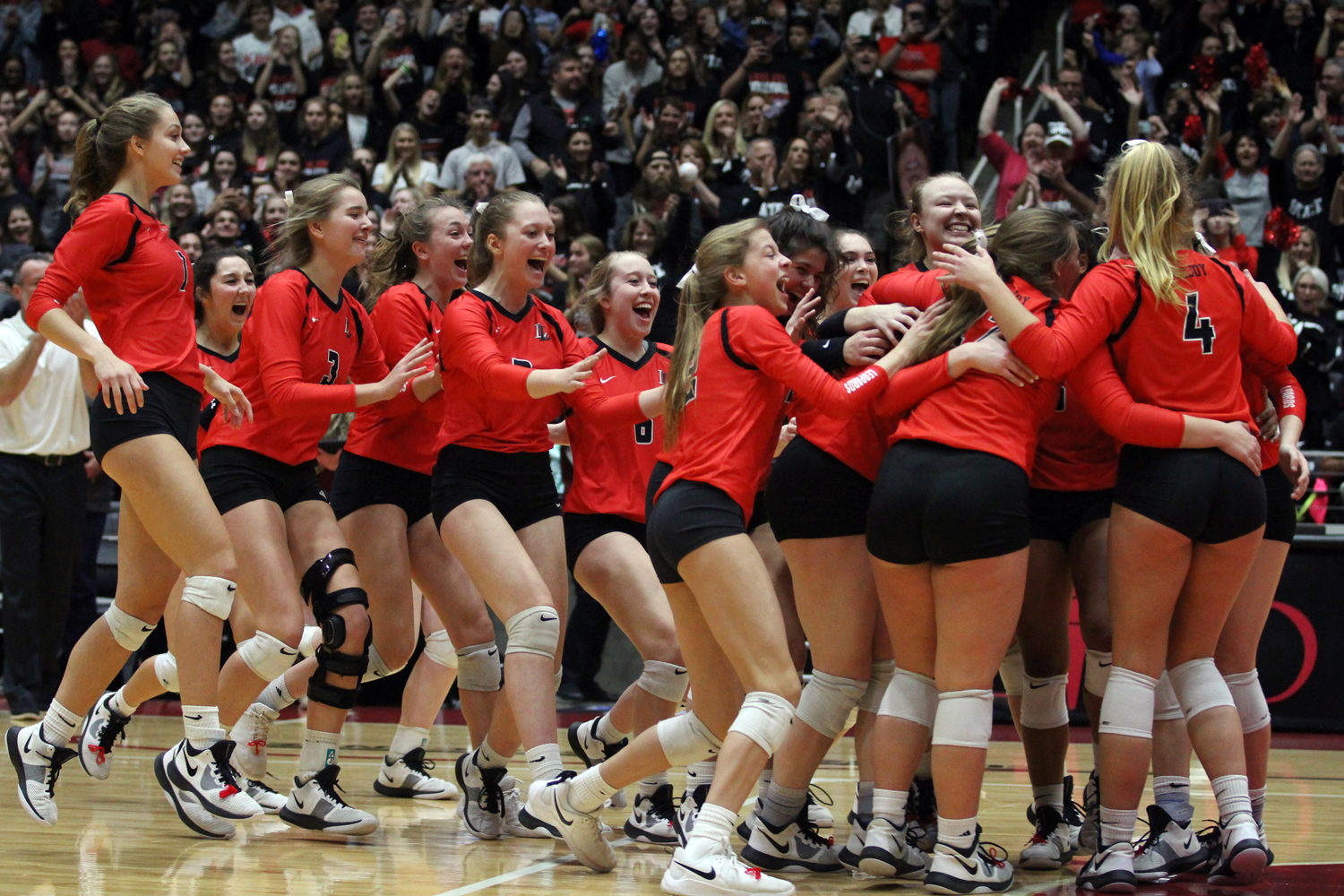 The Leopards celebrate on the court after winning their semi-final game against Dripping Springs Friday at the Curtis Culwell Center in Garland.