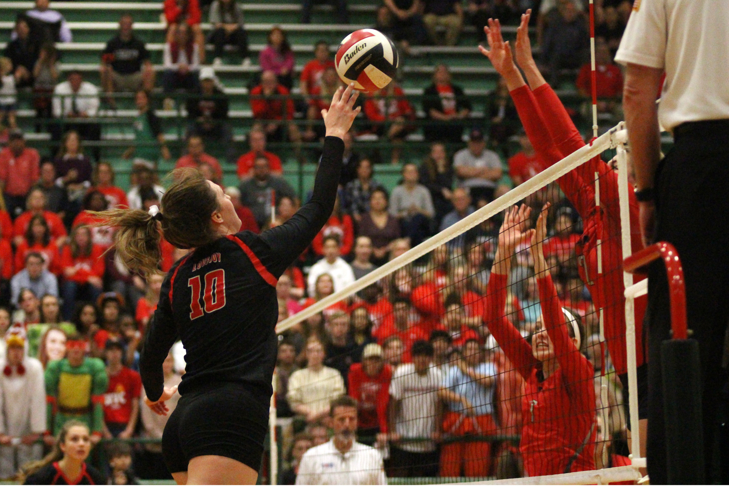 Senior+Madison+Waters+hits+the+ball+over+Frisco+Liberty+defenders.