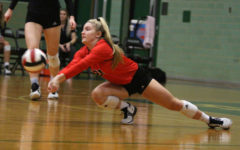 Senior Michelle Foster dives to defend a hit from an outside hitter.