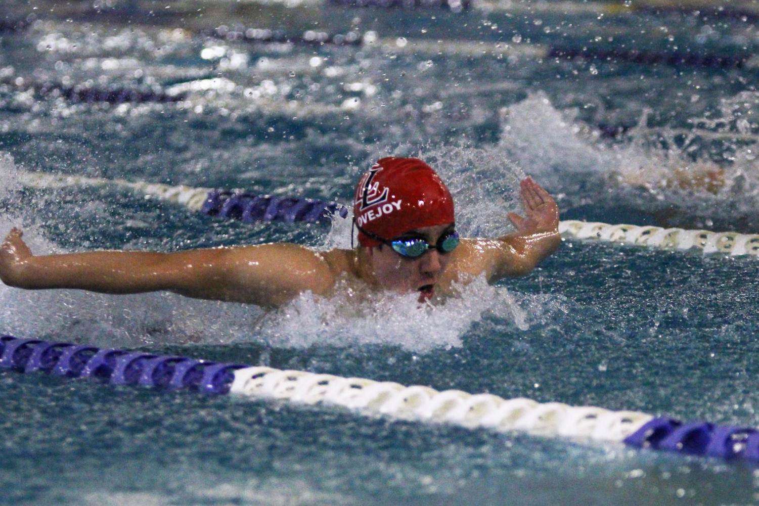 Freshman Andrew James swims the butterfly in the 200 individual medley at the Dallas Cup in Plano on Friday, Nov. 9.