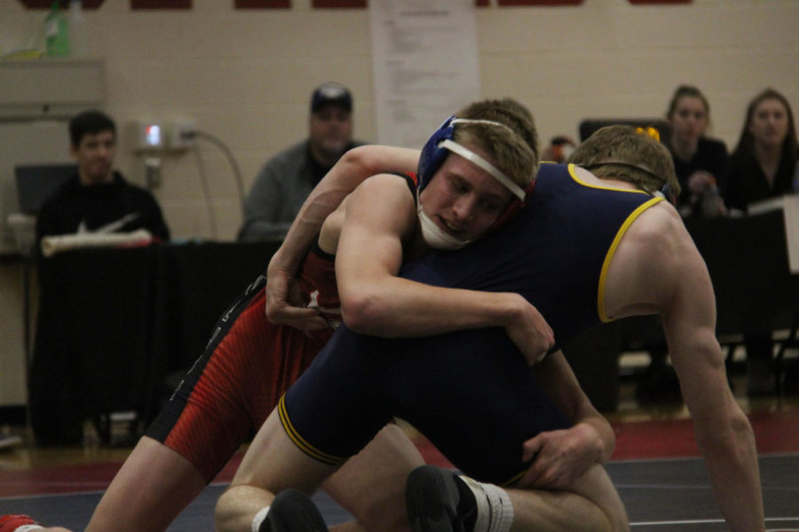Lovejoy Wrestler attempts to take down his opponent.