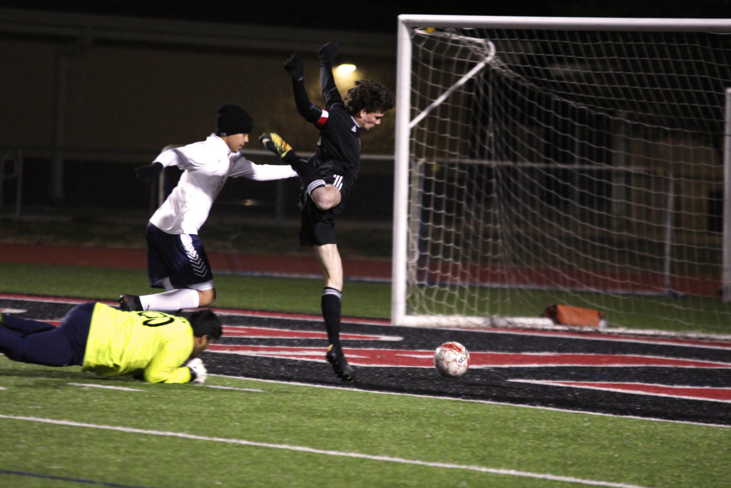 Senior forward Benji Merrick scores a goal after evading the goalie.
