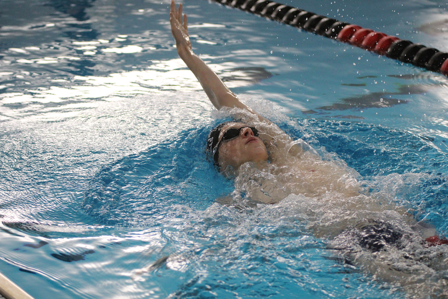 Junior Jed Jones practices his backstroke. At state, Jones placed first in the 200 IM and 500 freestyle.