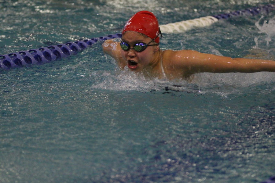 A lovejoy swimmer does the butterfly stroke at a practice.