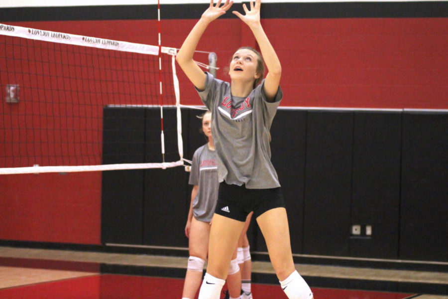 Freshman Averi Carlson looks to complete a set during Volleyball practice.