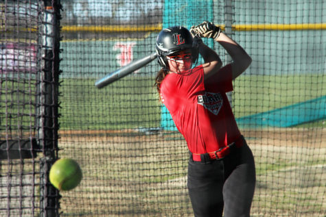Junior Carlee Schaeffer takes a swing in the batting cage.