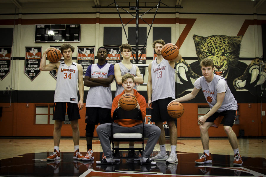 [From left] Seniors Trevor Hawley, Jonathan Lawrence, Luke Ledebur, Kyle Olson, Joe Vastano and Drew Doig (center) pose in the main gym.