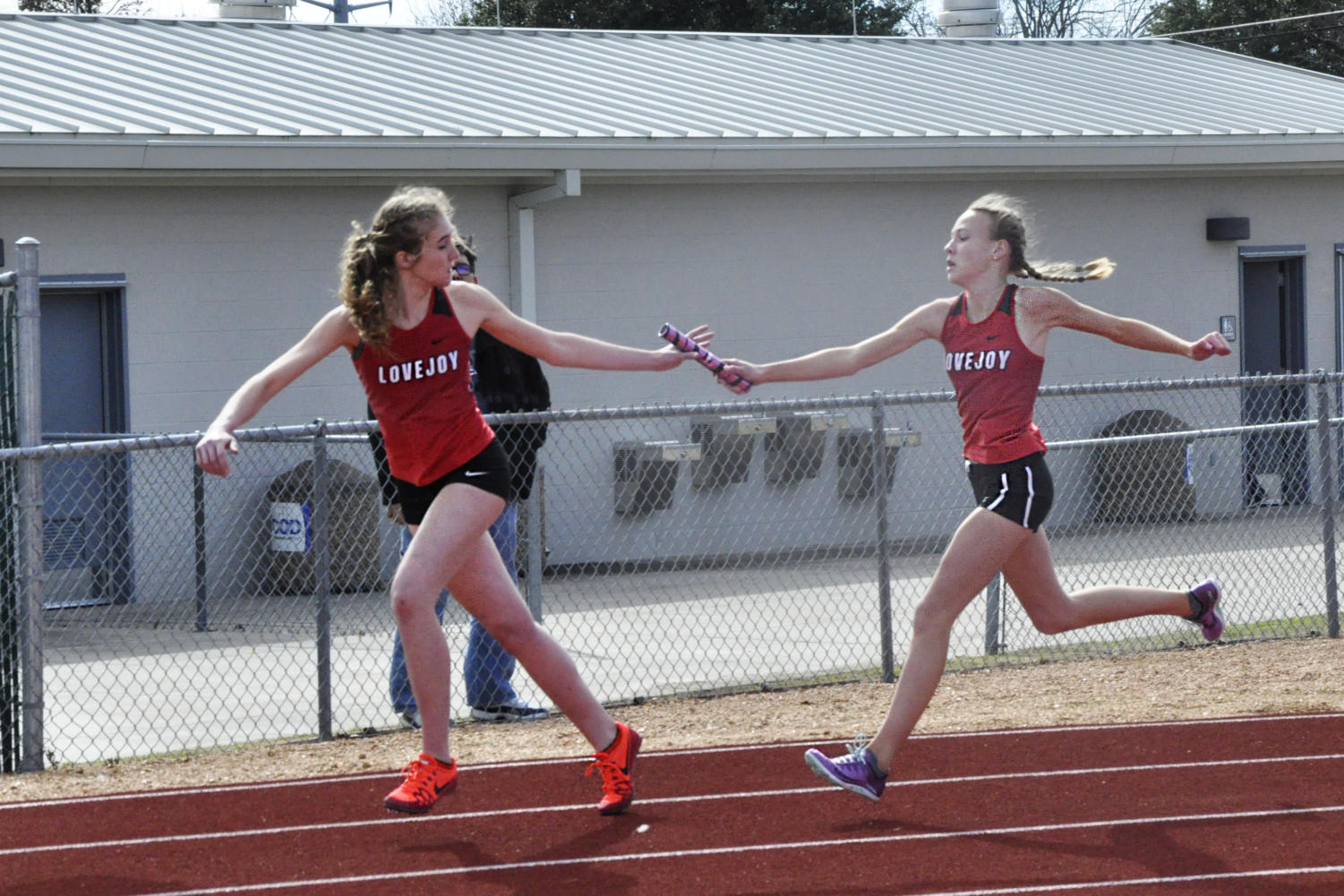 Freshmen Katie Armstrong and Lakin Hockersmith exchange the baton in the 4x200 m relay.