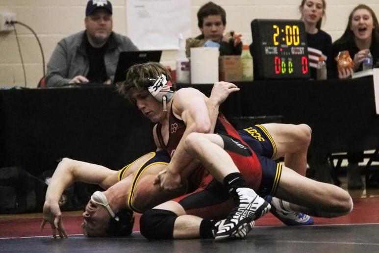 Junior Hunter Duncan pins a Highland Park wrestler during his match.