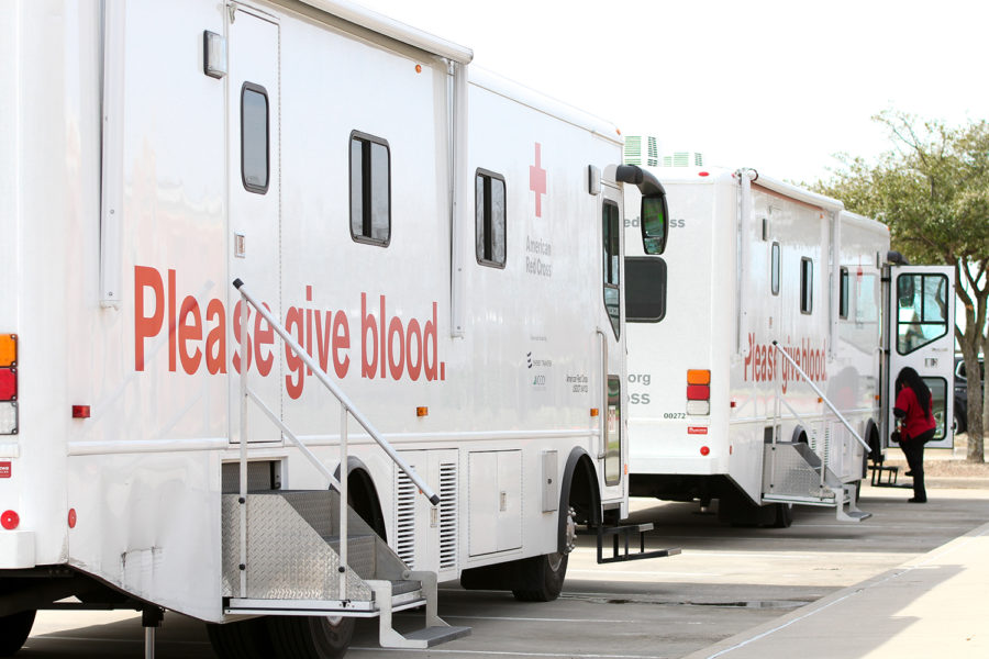 Two+Blood+Drive+buses+park+at+the+front+of+the+school+holding+six+different+seats+for+students+to+participate+in+the+blood+drive.+The+blood+drive+took+place+on+March+6%2C+2019.
