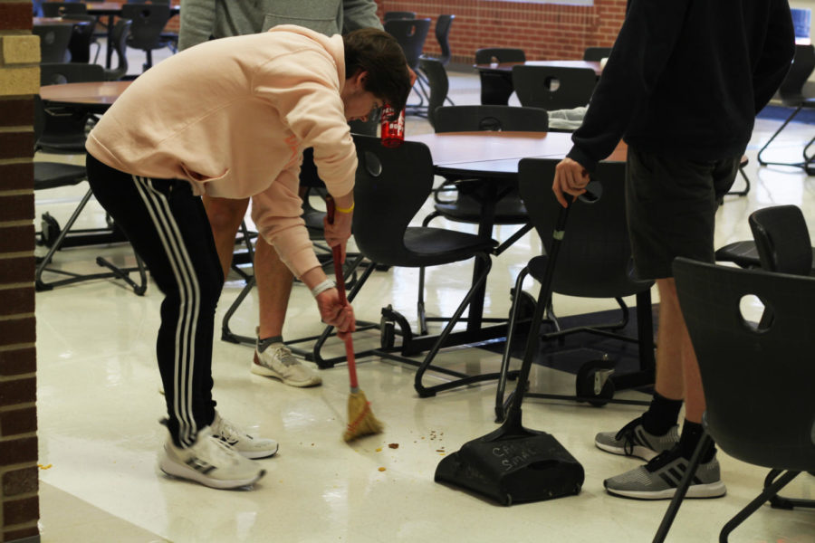 Senior Alec Welhouse and other STUCO members helped show kindness to faculty by sweeping the cafeteria.