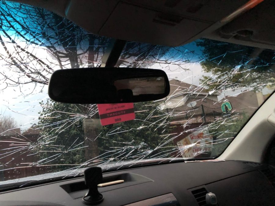 Junior+Andrew+Khalil+waited+in+his+car+partially+under+a+gas+station+roof+during+the+March+24+severe+hail+storm.+Hail+dented+his+car+and+shattered+the+windshield.