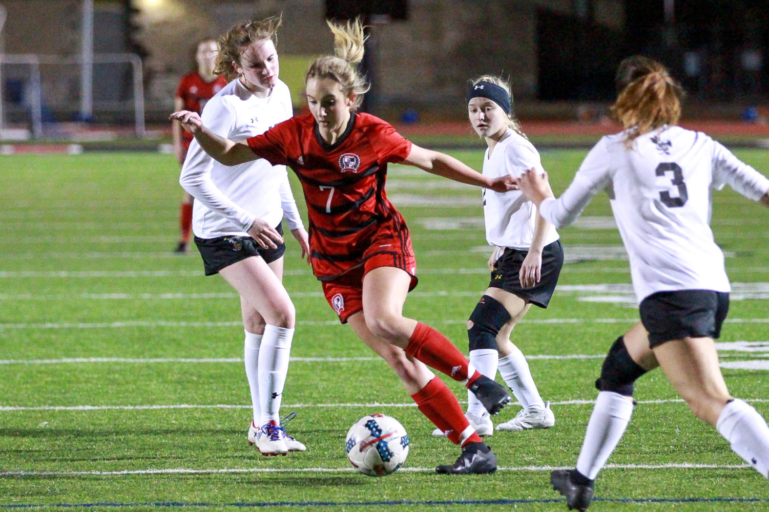 Freshman Tatum Chester picks the ball and looks towards the goal.