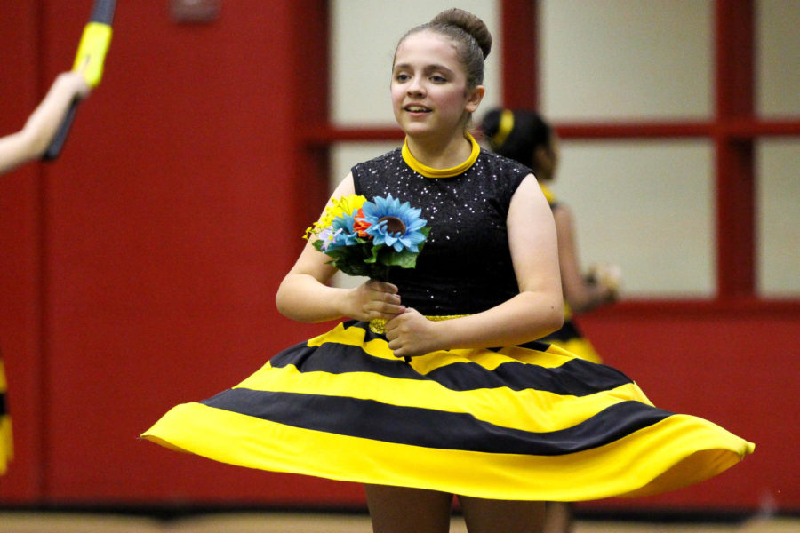 During+the+beginning+of+the+seventh-grade+performance+%22Honey+Bee%2C%22+twirls+with+a+bouquet+of+flowers.