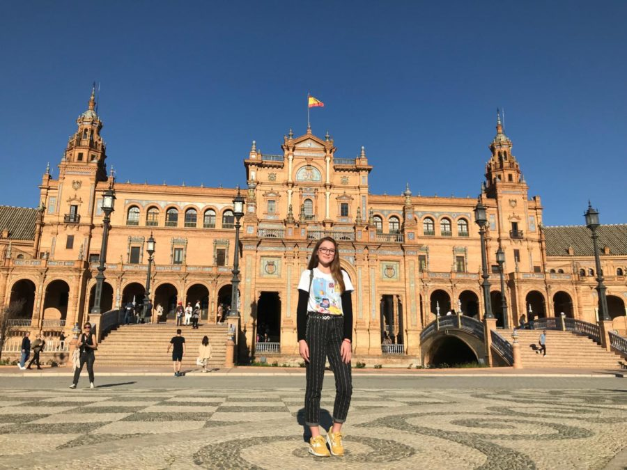 Senior Abigail Lund stands in the center of Plaza De España in Seville, Spain.
