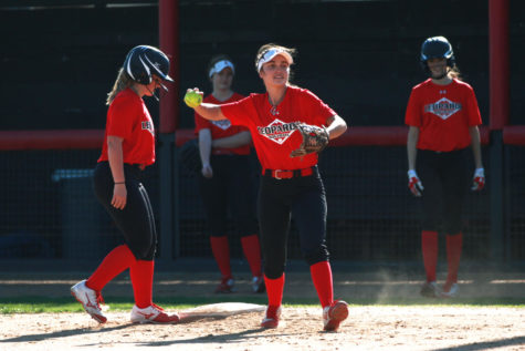 Junior Carlee Schaeffer gets an out from a throw by senior Delaney Dicristofaro during a first and third base situation.