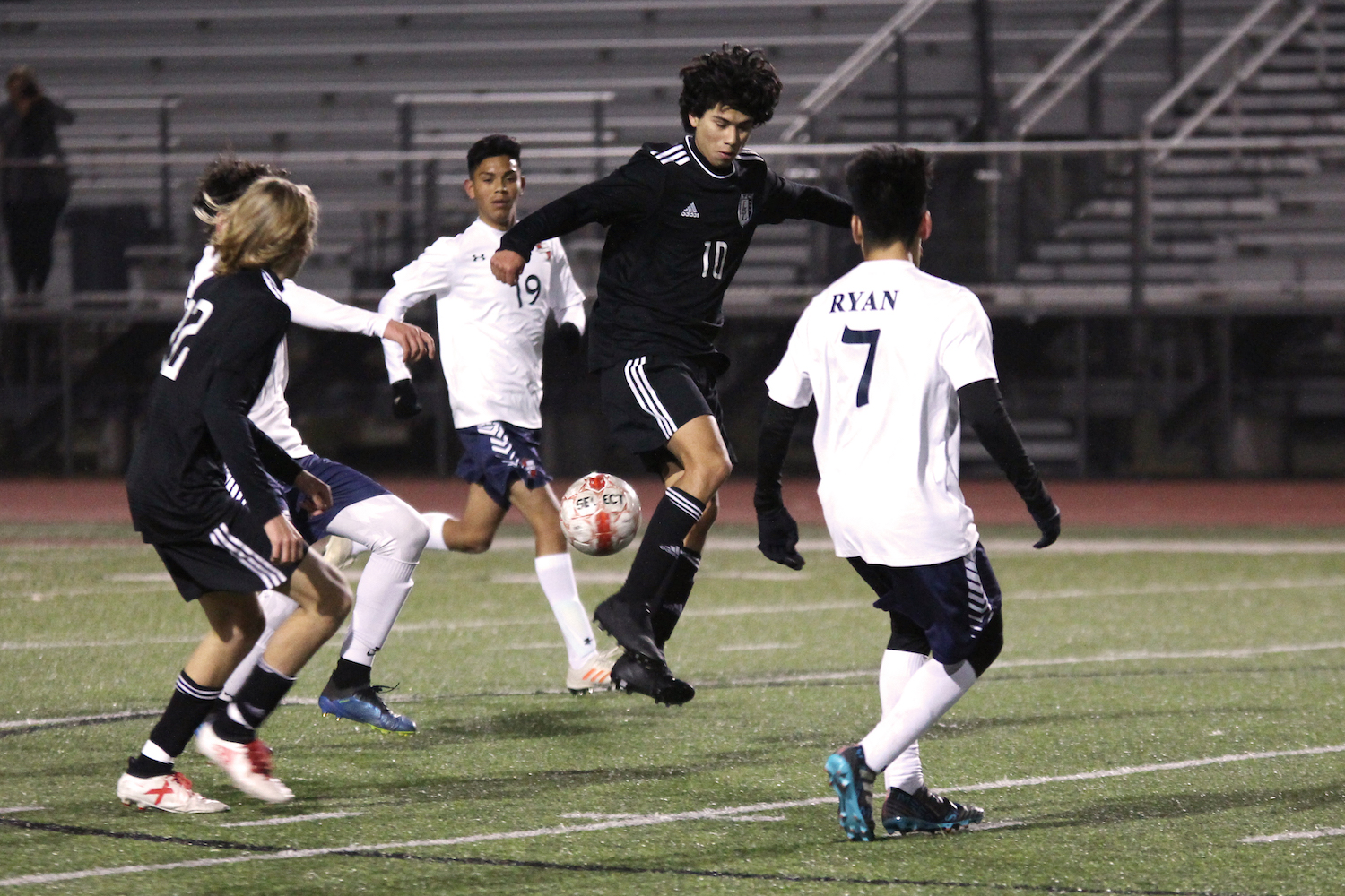 Junior Diego Rodriguez attempts to block a pass between two Wylie East teammates.