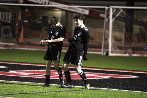 Senior forwards Benji Merrick and Trey Reiner congratulate each other after their teammate scores a goal.