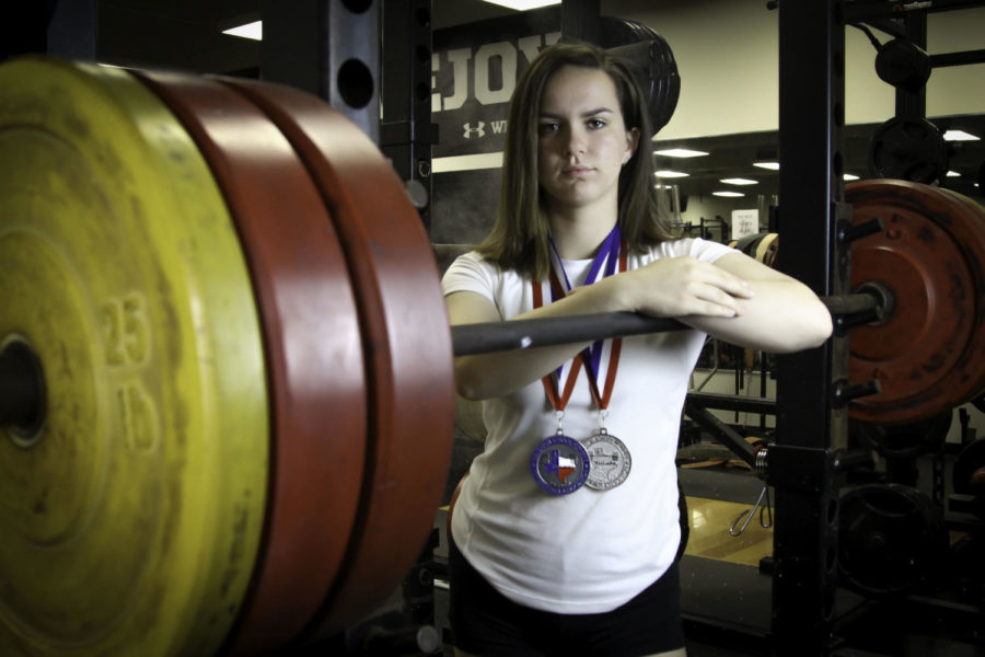 Senior+Ally+Carraway+transitioned+from+volleyball+to+powerlifting+and+became+the+5A+state+record+holder+in+the+bench+press+for+her+weight+class+this+season.%0A