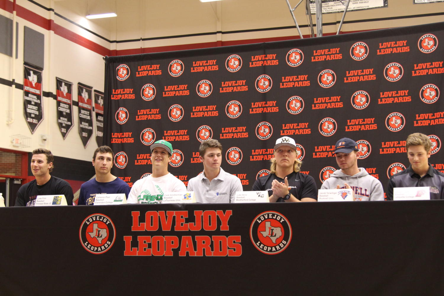 The+senior+baseball+players+prepare+to+sign+their+letters+of+intent.+