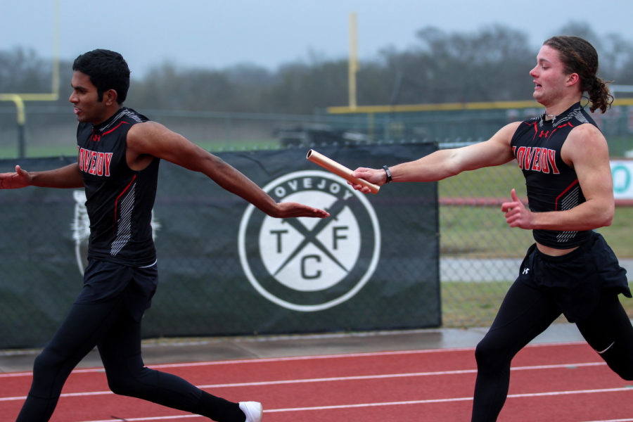Sophomore Sam Clay hands off the baton to senior teammate Andrew Godipelly.