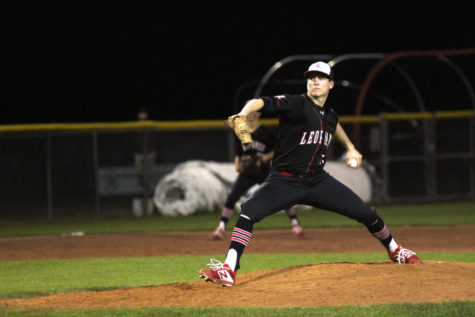 Senior Cameron Pool throws a pitch during a Tuesday game.