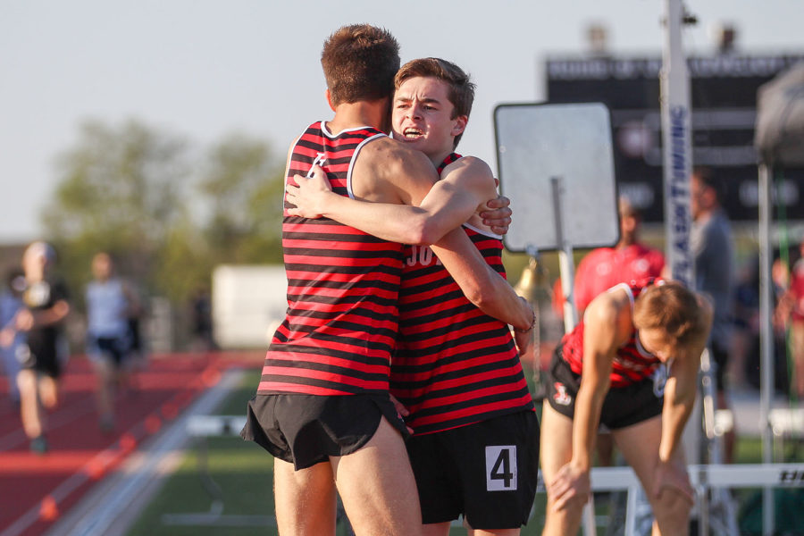 Senior+Chayden+Du+Bois+and+freshman+Riley+McGowan+embrace+after+Lovejoy+secures+first%2C+second+and+third+place+in+the+800M+event.