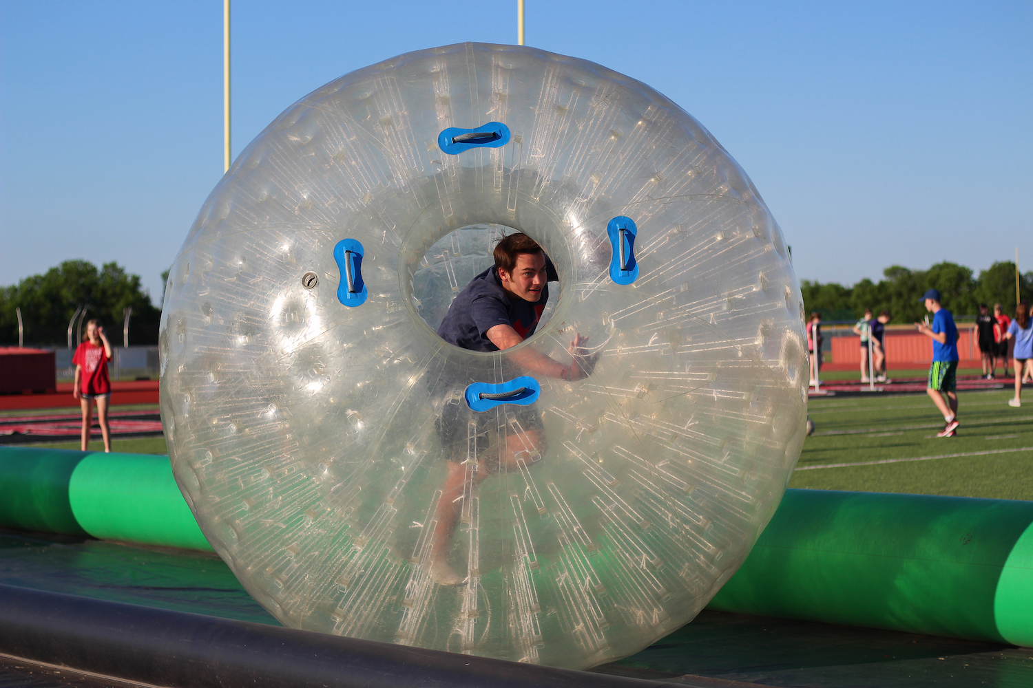 Junior+Derek+Fisher+participates+in+the+hamster-ball+activity+before+students+start+to+line+up+for+the+survivors%27+lap+to+begin