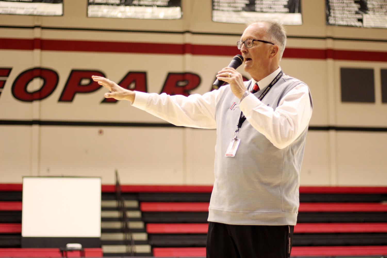 +Lovejoy+athletics+director+Jim+Bob+Puckett+introduces+the+event+and+athletes+at+the+beginning+of+signing+day.+He+also+introduced+each+individual+athlete+between+their+coaches+talking+about+them.%0A