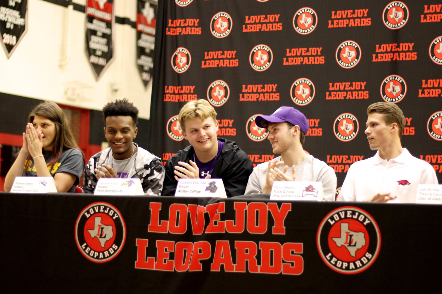 +Athletes+Alex++%2C+Solomon+Awoke%2C+Nathaniel+Finch%2C+Jackson+Diamond%2C+and+Ryan+Gordon+after+they+signed+their+papers+for+their+college.+There+was+a+mix+of+colleges+and+sports+at+the+signing+event+on+April+17.%0A