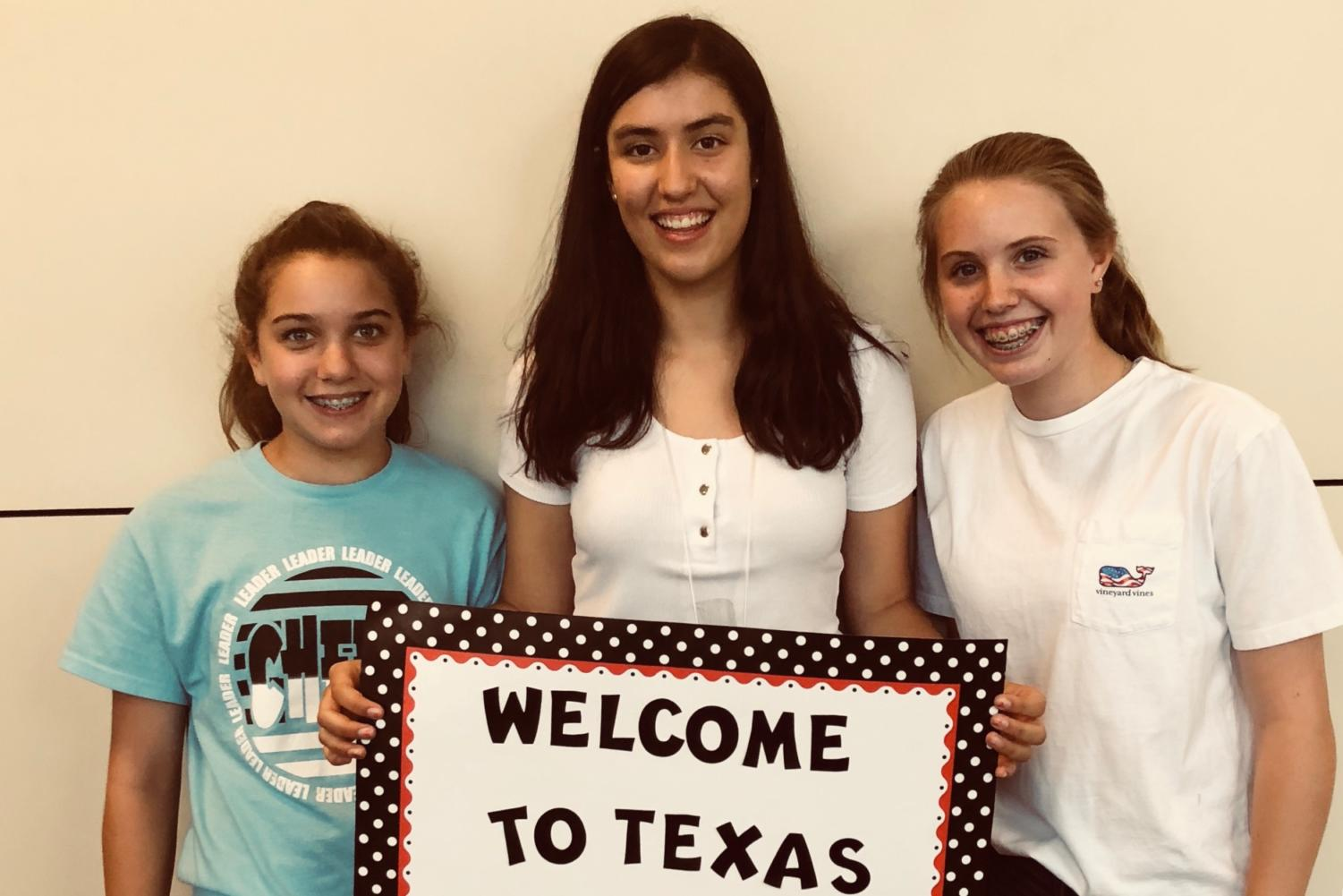 Maddi and Katelyn Rumsey welcome exchange student Isabel Martinez at DFW airport when Martinez first arrived.