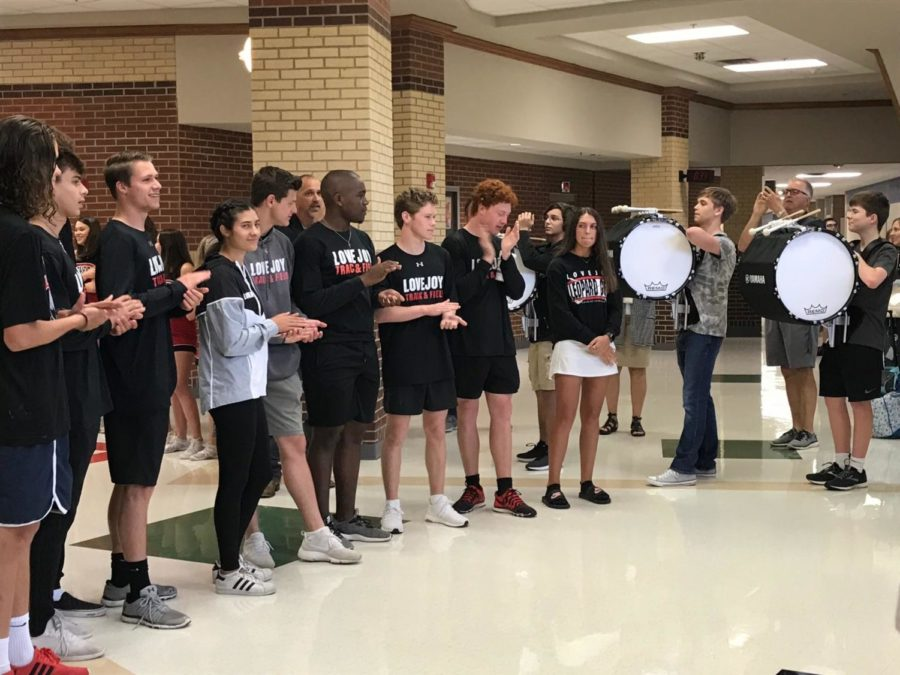 The track team is recognized during this morning's sendoff.