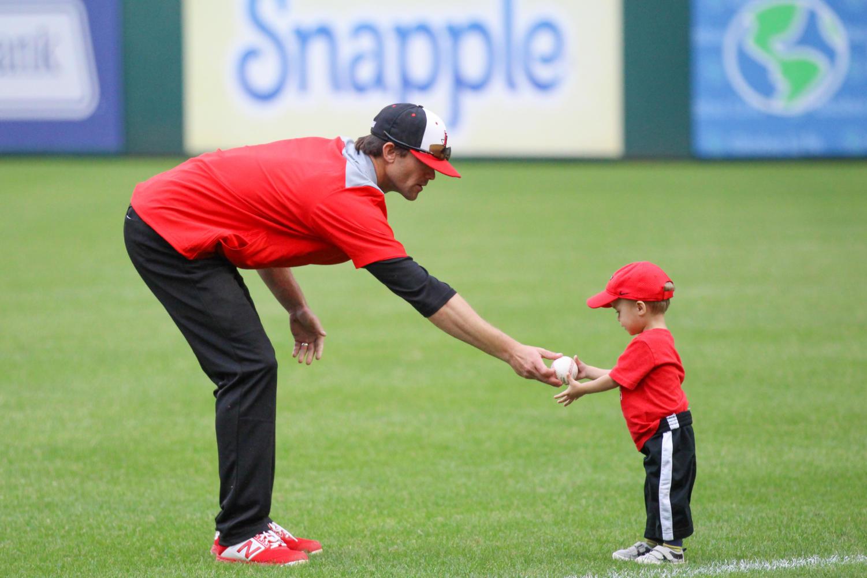 Coach+Casey+Jones+brings+his+son+onto+the+Texas+Rangers+field.