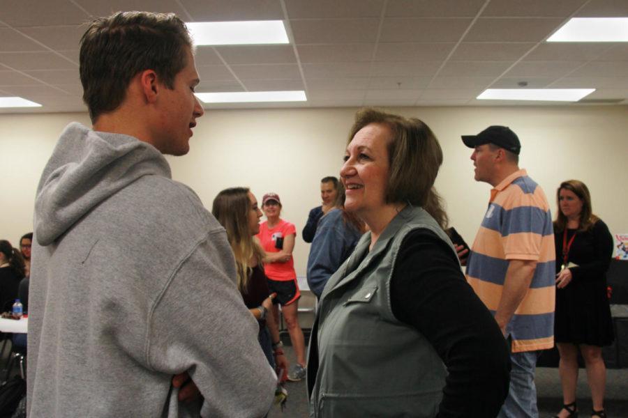 Senior Ryan Gordon reunites with retired Hart music teacher Debbie Noble.