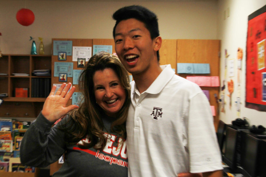 Senior Christian Kwon and Shelley Cano  embrace in the elementary's GT classroom.