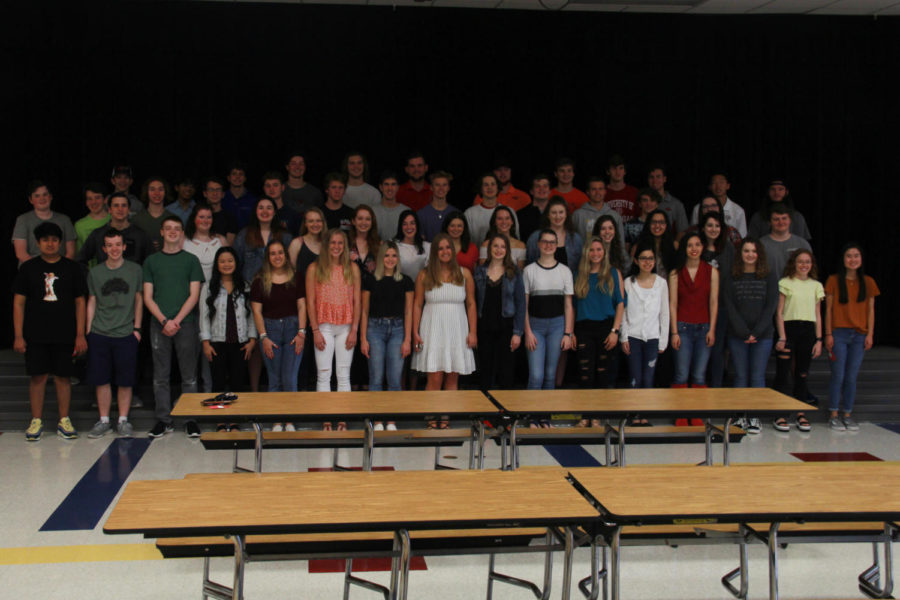 Seniors who attended Hart elementary pose on stage together. Groups of other seniors also attended their respective elementary schools.