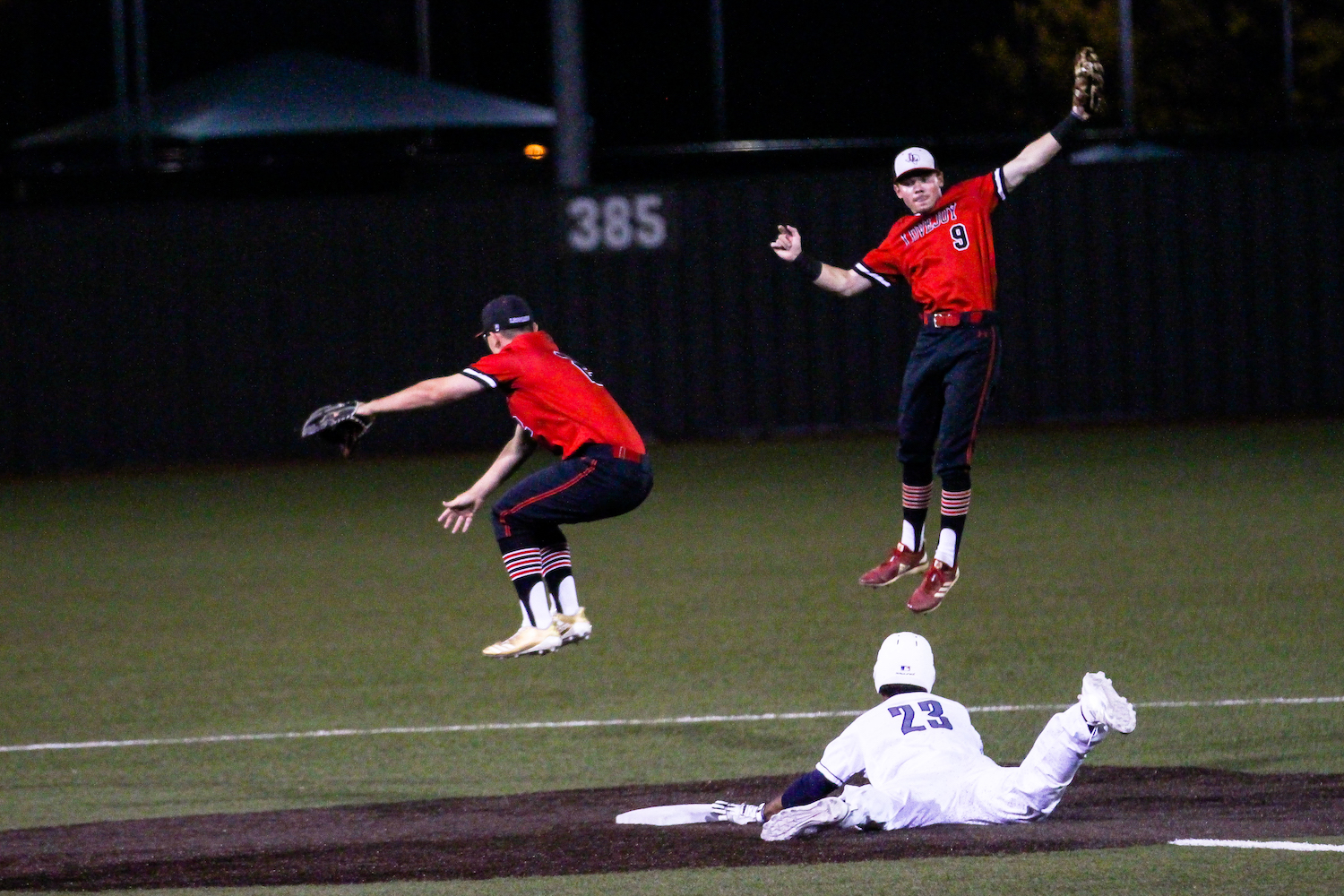 Senior+Jacob+Terwilliger+jumps+to+catch+the+ball+and+make+an+out+on+second+base.
