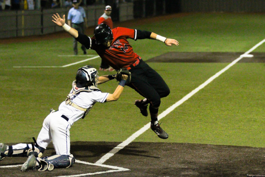 Sophomore Ralph Rucker fails to dodge a Lone Star catcher as he attempts a run at home base.