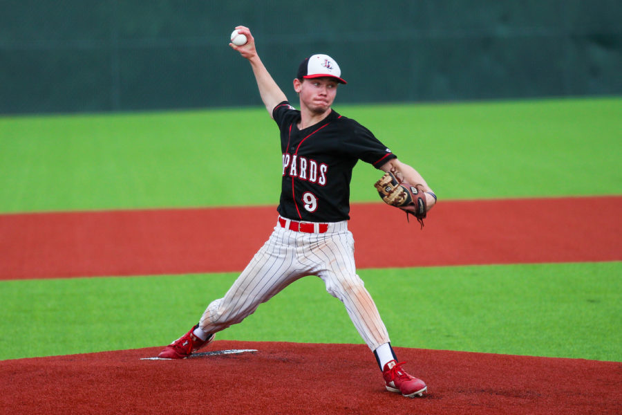 Senior Jake Terwilliger pitches at the beginning of the third playoff game which ultimately ended in a 7-8 loss.