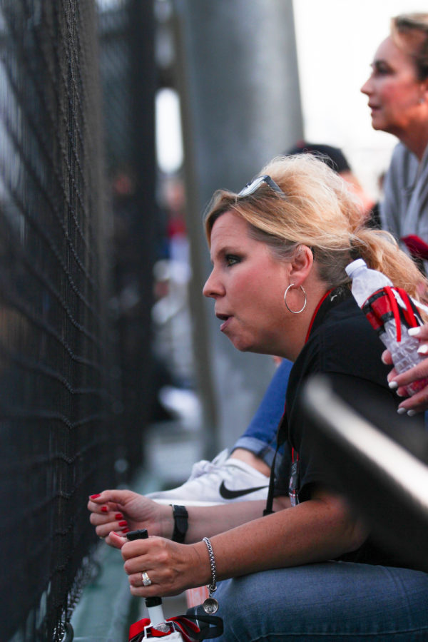 Lovejoy parent Stacey Stine cheers on players as the game ties 7-7 in the seventh inning.