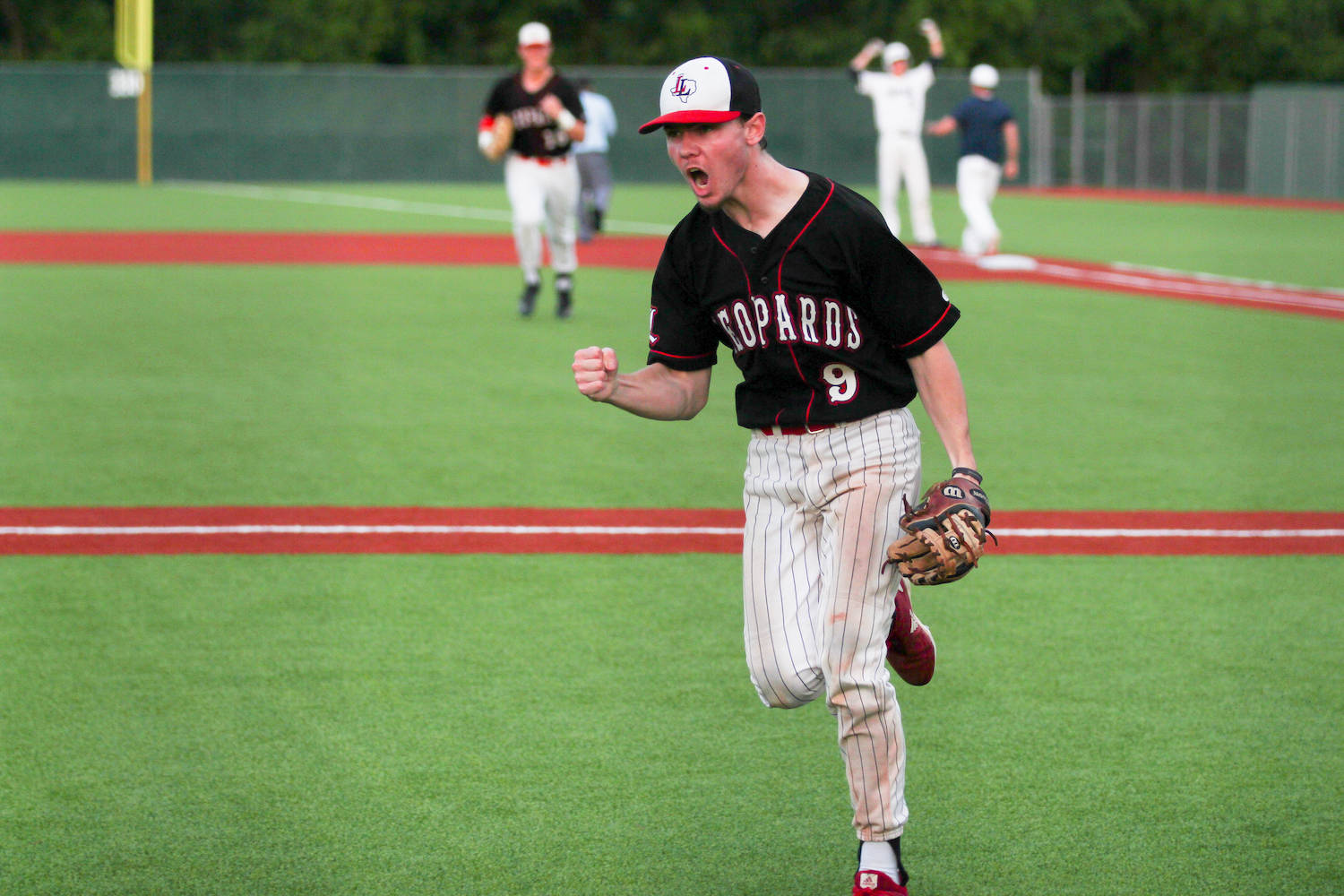 Senior+Jake+Terwilliger+celebrates+as+the+Leopards+tie+the+game+7-7+in+the+seventh+inning.+